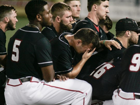 Ragin' Cajuns designated hitter Brenn Conrad holds his head down during a team gathering after UL's 3-1 loss to Arizona in the NCAA Lafayette Regional championship game Monday at The Tigue Field.