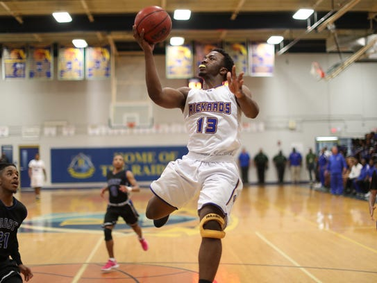 Rickards' Gentry Sparks lays the ball up against Godby