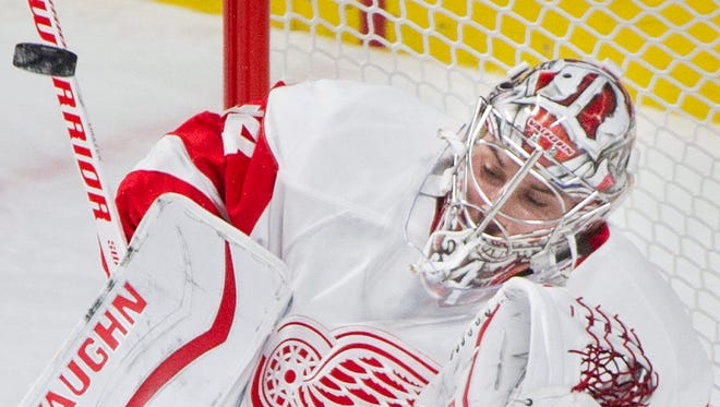 Red Wings goaltender Petr Mrazek makes a save against the Canadiens during second period Saturday in Montreal.