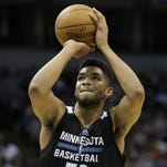 Minnesota Timberwolves center Karl-Anthony Towns (32) shoots a free-throw during an NBA scrimmage on July 8 in Minneapolis.
