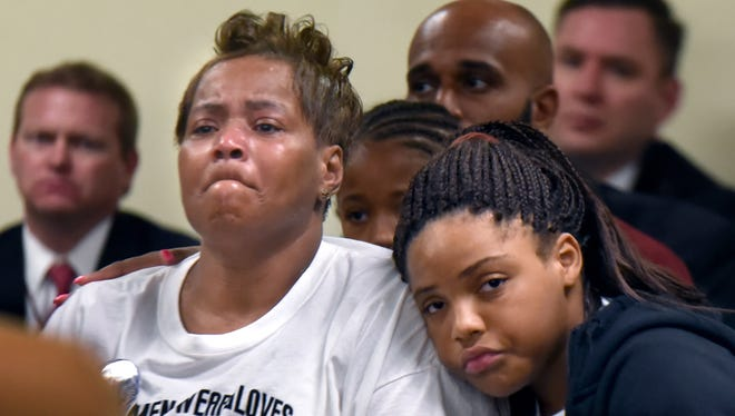 Nate Plummer Jr.'s grandmother Darlene Adderly and his sister Natijah Plummer, 10, at an arraignment Friday for Casche Alford in Plummer's slaying.