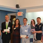 The five winners of the second annual Monk's Home Improvements Service Scholarship were each awarded their $2,000 scholarship at the Monk's Home Improvements headquarters in Morristown earlier this month. From left: Jennifer Bruckstein of Berkeley Heights, Trevor Monk, Samantha Snyder of Warren, Christopher Stone of Fanwood, Viviane Monk, Ryan Bonk of Mountainside, Isabella Monk, Ty Monk, Olivia Diaz-Saavedra of Chatham and John Monk.