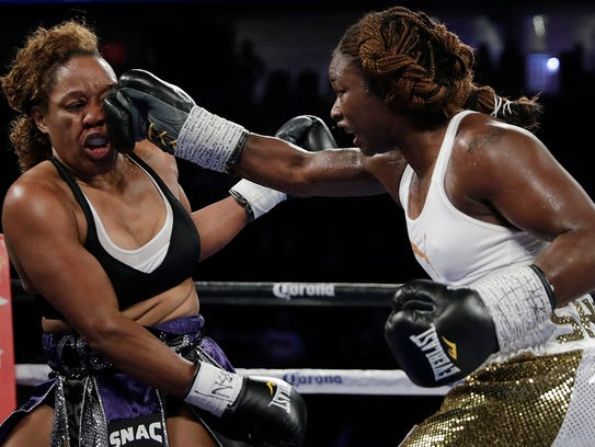 Franchon Crews, left, and Claressa Shields fight during