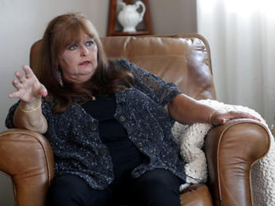 Sitting in the living room of her Howard, Wis. residence on July 11, 2018, Laura Kiefert talks about the chronic pain she suffers from due to diabetes and how she thinks medical marijuana may help.