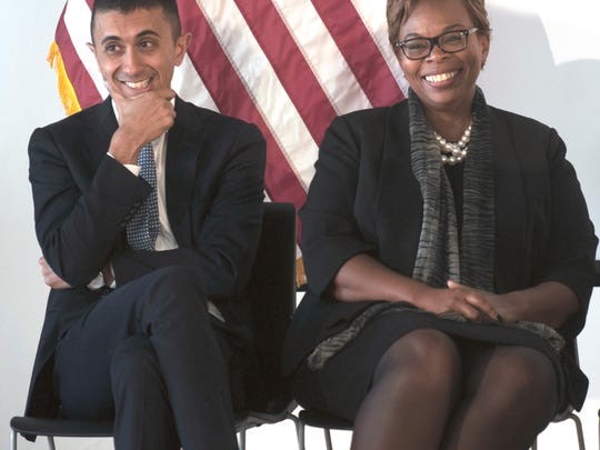 Camden Superintendent Paymon Rouhanifard and Camden Mayor Dana Redd, smile during New Jersey Governor Chris Christie's remarks on the State of Education in Camden, Friday  Sept. 15, 2017. The ceremony took place at the new renovated KIPP Whittier Middle School in Camden, N.J.