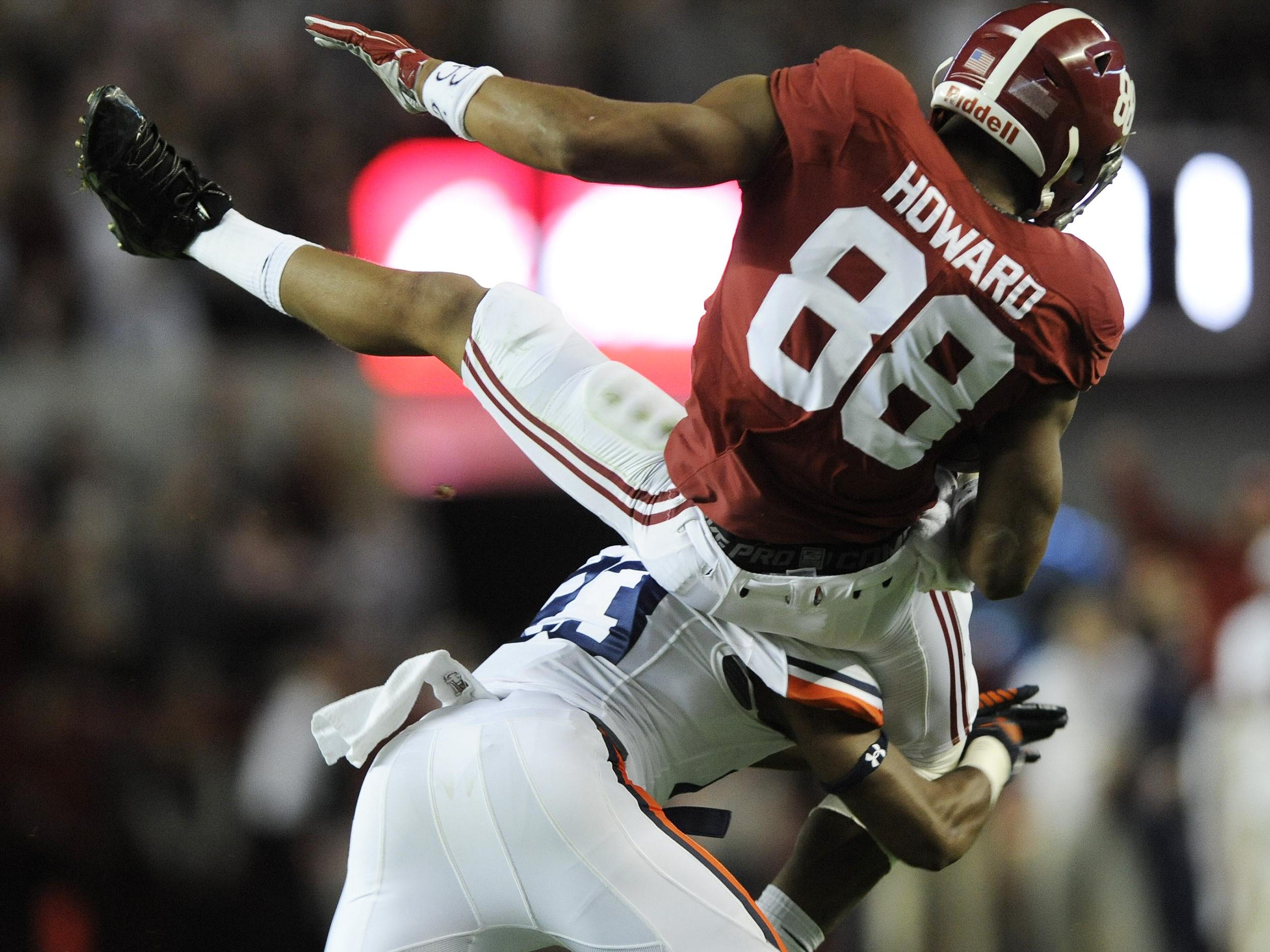 Alabama tight end and Autaugaville native O.J. Howard is tackled by Auburn defensive back Johnathan Ford during last year's Iron Bowl game in Tuscaloosa. Auburn's defense is wary of Howard's ability.
