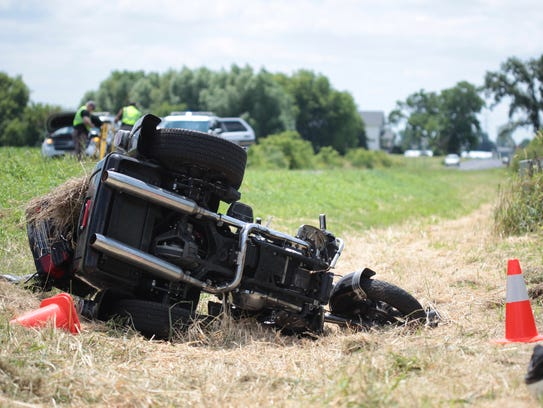 A motorcycle lies in a ditch following an accident