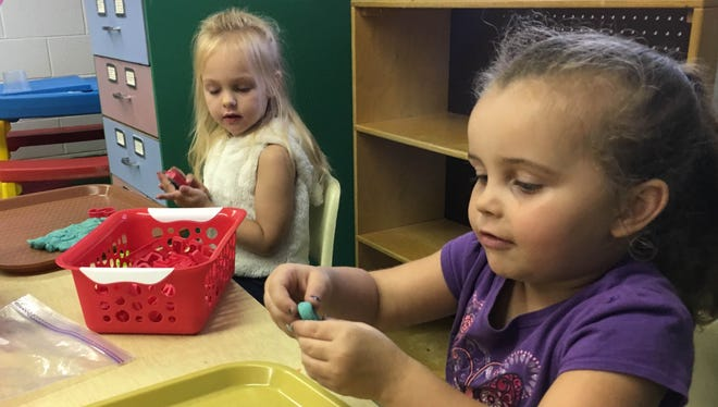 Paige Brantlinger (left) and Ahkhira Burke (right) play in the art room at Friends Preschool Academy. They are two of six students enrolled in the summer day care program.
