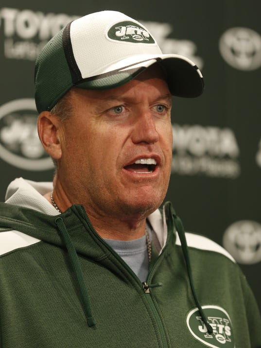 New York Jets head coach Rex Ryan talks to reporters during an NFL football organized team activity, Wednesday, May 28, 2014, in Florham Park, N.J. (AP Photo/Julio Cortez)