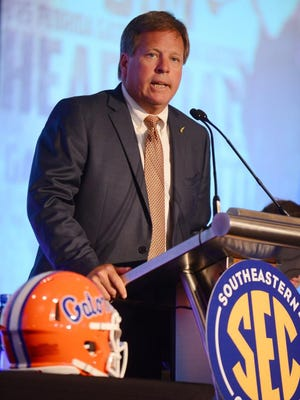 Florida Gators football coach Jim McElwain fields questions during SEC Media Days on Monday in Hoover, Ala.