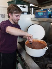 Stephen Griffin, a site manager at Immanuel Shelter near Rehoboth Beach, stirs a pot of chili.