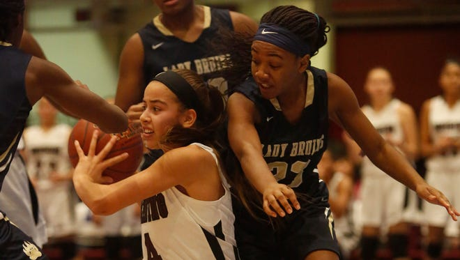 Ossining's Jaida Strippoli fights for possession with Baldwin defenders  during the semifinals at the 18th Annual Slam Dunk Tournament at the Westchester County Center in White Plains on Wednesday. Baldwin won 83-73.