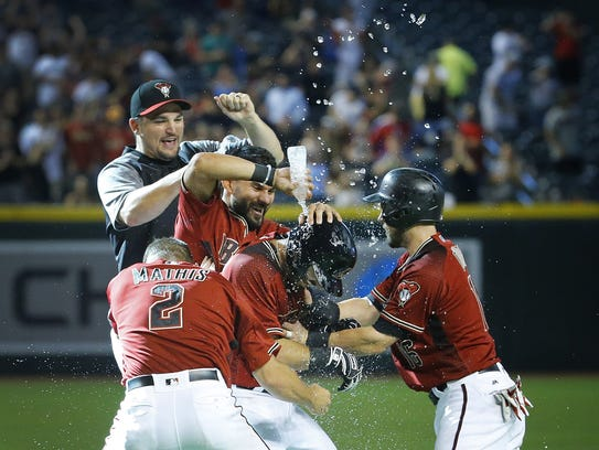 Teammates celebrate with Daniel Descalso (3) following