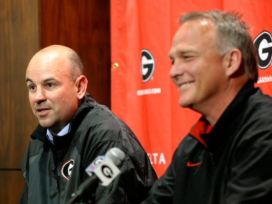 Jeremy Pruitt, left, is introduced as Georgia's new defensive coordinator by head football coach Mark Richt, right, on Jan. 15, 2014, in Athens, Ga.