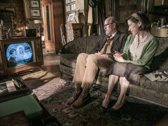 Elisa (Sally Jenkins) is able to confide in her neighbor Giles (Richard Jenkins) about her unconventional new love.