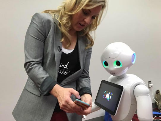 Jennifer Jolly and Pepper the robot.