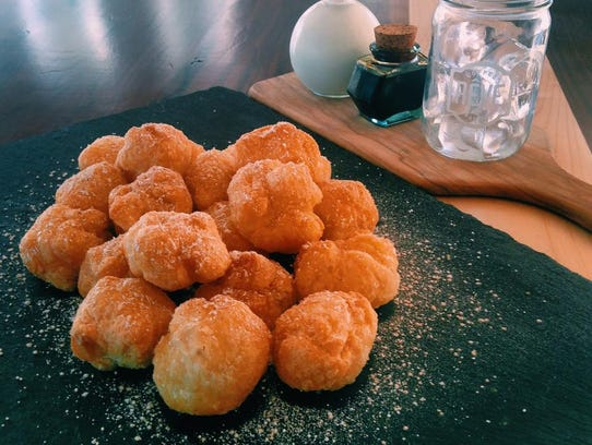 Beignants, deep-fried and covered in cinnamon, honey