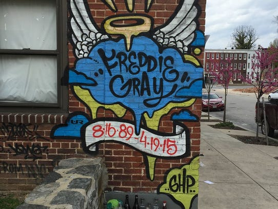 A small mural in West Baltimore marks the spot where