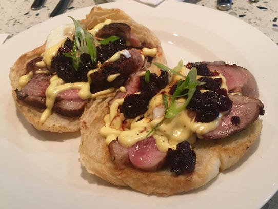 The duck Benedict at EnVie, located at 210 S. Washington