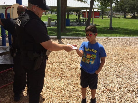 Palm Bay police officers handled out coupons for free