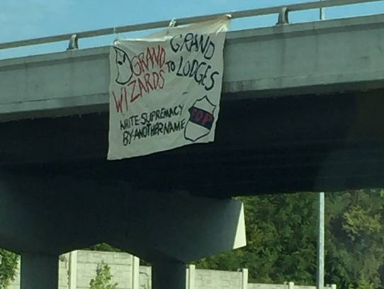 Members of SURJ and other groups hung banners from
