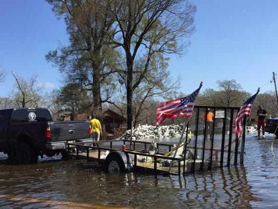 Delivering sandbags during the flood of North Louisiana
