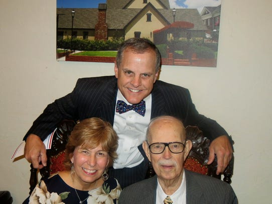 """Jennifer and Pete Zanmiller and Delton Harrison at """"This Is Your Life"""" celebration."""