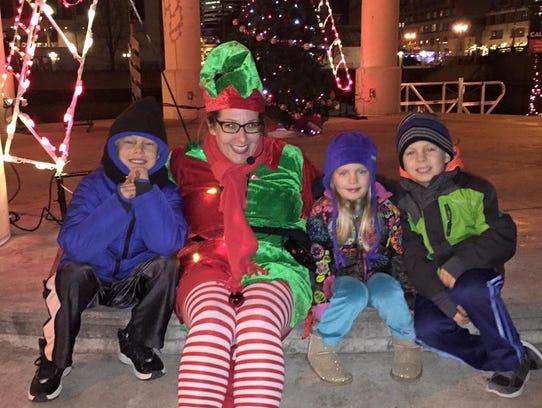 Anna Lardinois dresses as an elf for her Christmas-themed