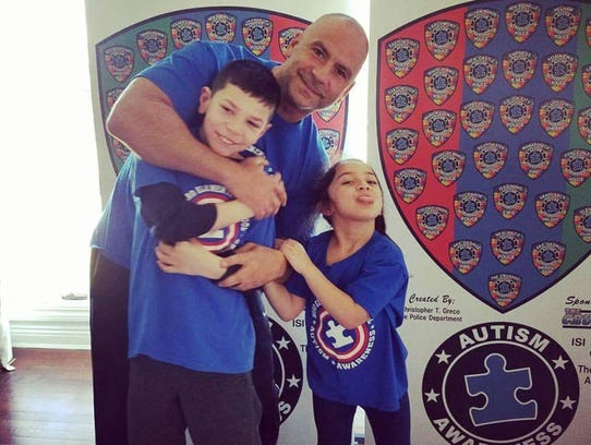 Chris Greco and his children, Christopher, 11, and