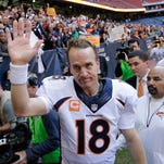 In this Dec. 22, 2013, file photo, Denver Broncos' quarterback Peyton Manning (18) waves to fans following an NFL football game against the Houston Texans in Houston. Manning threw his 51st touchdown pass of the season in the game to set a new NFL record. Manning's next touchdown throw will be his 500th, and if the trend holds true, it will be caught by a tight end, not a wide receiver. Denver plays at home against Arizona on Sunday, Oct. 5, 2014.