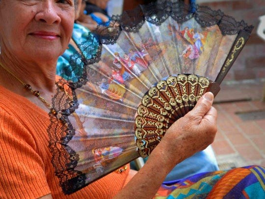A lady with a fan caught photographer Dennis Connolly's
