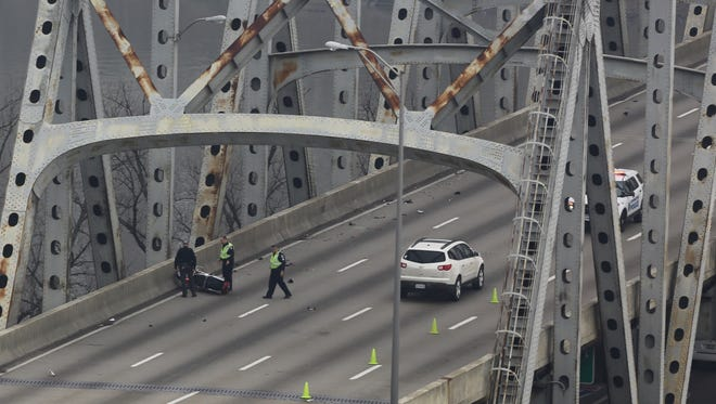 Officials investigate a fatal crash on the Brent Spence Bridge Friday morning.
