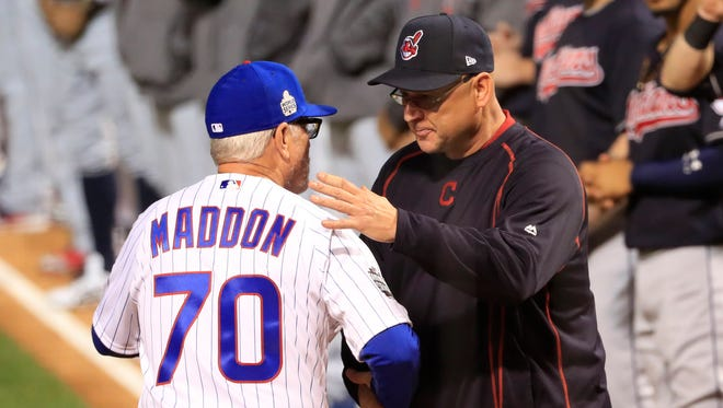 Oct 28, 2016; Chicago, IL, USA; Chicago Cubs manager Joe Maddon (70) shakes hands with Cleveland Indians manager Terry Francona (right) before game three of the 2016 World Series at Wrigley Field. Mandatory Credit: