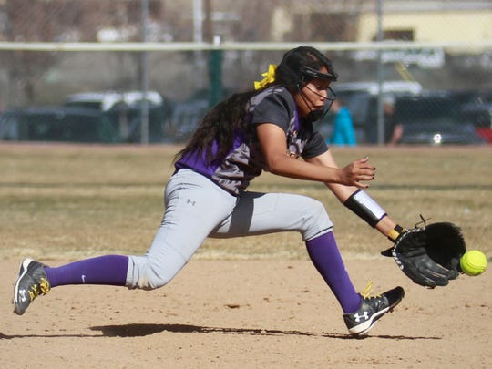 Kirtland Central's Nikki Begay fields the ball during a game on Friday at the Farmington Sports Complex.