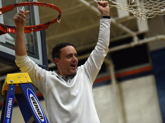 Carson-Newman coach Mike Mincey celebrates winning