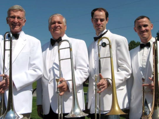 The trombones of Slide Show, left to right, Lynn Lerew,