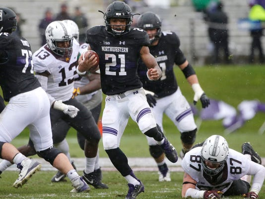 Northwestern running back Justin Jackson (21) runs with the ball against Minnesota during the first half of an NCAA college football game in Evanston, Ill., Saturday, Nov. 18, 2017. (AP Photo/Nam Y. Huh)