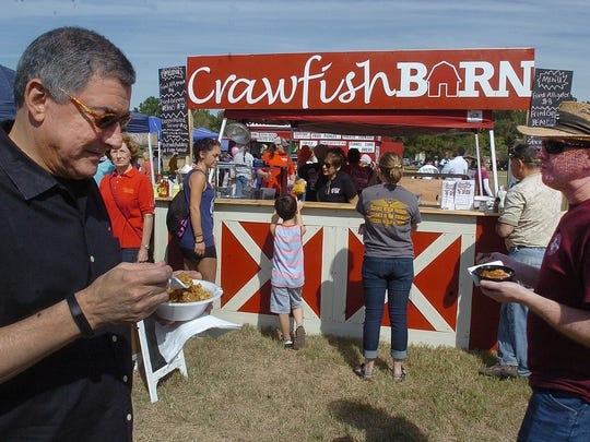 Lt. Gov. Jay Dardenne samples a bowl of jambalaya while enjoying a fun day at the Experience Louisiana Festival Saturday in Eunice. See a photo gallery at dailyworld.com and on Facebook.