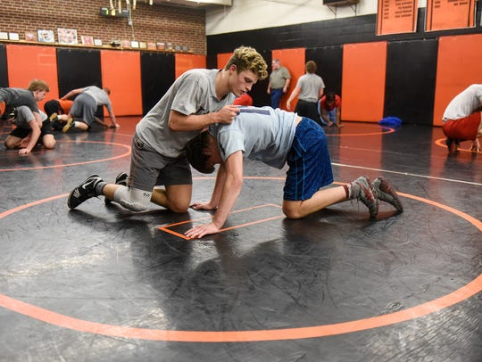 St. Cloud Tech's Austin Brenner works with a teammate