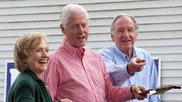 Hillary Clinton, Bill Clinton, and Sen. Tom Harkin, D-Iowa, in Indianola, Iowa.