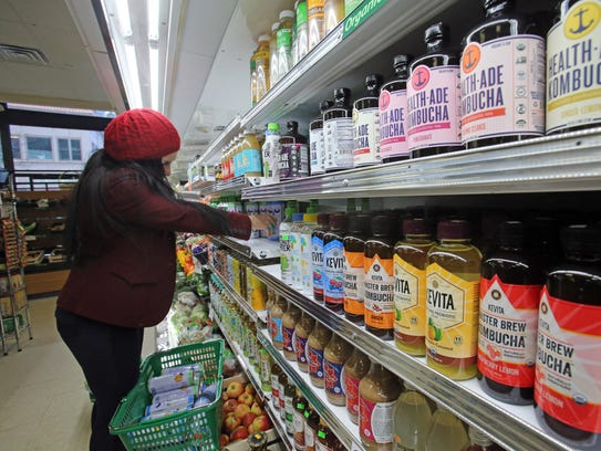 Luisa Sanchez stocks the shelves at the Only Mart in