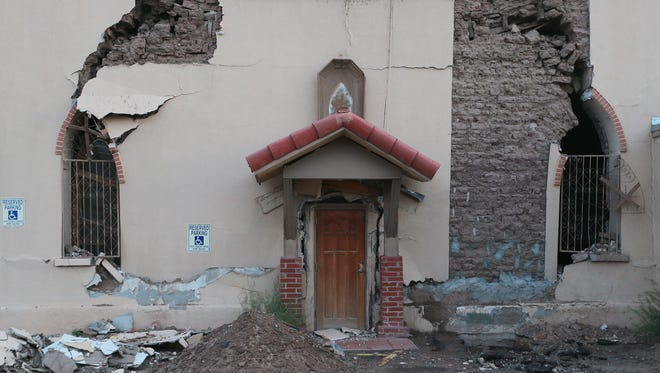 An east side entrance to San José Catholic Church shows its disrepair.