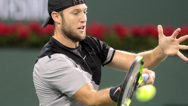 Jack Sock returns the ball to Feliciano Lopez, of Spain, during the men's 3rd round at the BNP Paribas Open in Indian Wells, Tuesday, March 13, 2018.
