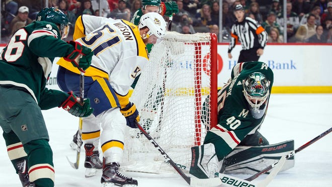 Mar 24, 2018; Saint Paul, MN, USA; Minnesota Wild goalie Devan Dubnyk (40) makes a save in the first period against Nashville Predators forward Austin Watson (51) at Xcel Energy Center. Mandatory Credit: Brad Rempel-USA TODAY Sports