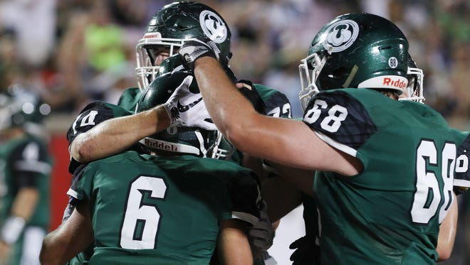 Trinity's Tony Palombino (6) celebrated with teammates after catching a touchdown pass against St. X during their game at Papa John's Cardinal Stadium.Sep. 29, 2017
