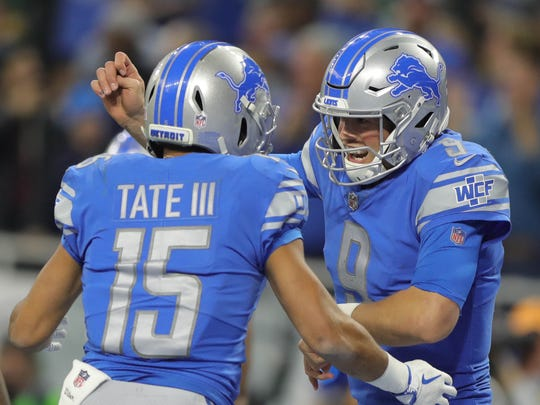 Matthew Stafford celebrates with Golden Tate after scoring on a two-point conversion pass from Tate in the fourth quarter against the Packers on Sunday.