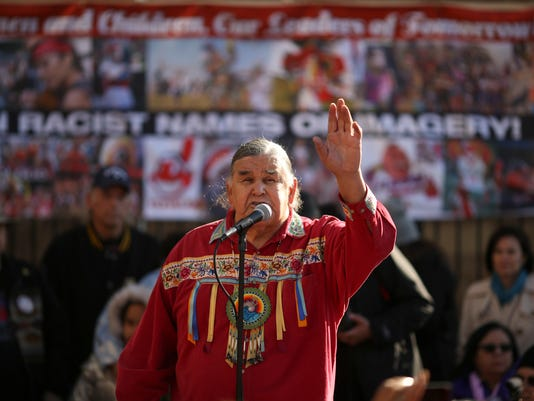 Longtime Native American activist and AIM co-founder Clyde Bellecourt addresses a rally outside TCF Bank Stadium in Minneapolis before the Vikings faced the Washington Redskins in a football game Sunday, Nov. 2, 2014. Opponents of the Redskins name believe it's a slur that mocks Native American culture and they want the team to change it. (AP Photo/The Star Tribune, Jeff Wheeler)  MANDATORY CREDIT; ST. PAUL PIONEER PRESS OUT; MAGS OUT; TWIN CITIES LOCAL TELEVISION OUT