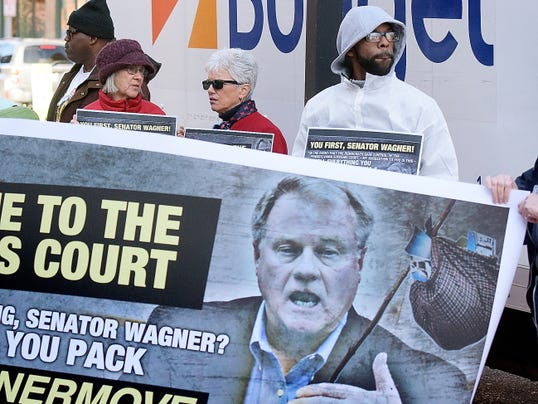 Demonstrators, from left, Mary Barnes of Springfield Township; Joan Fulton of West Manchester Township: and Glenn Grayson of Pittsburgh gather outside state Sen. Scott Wagner's York office Friday, Nov. 13, 2015. Grayson made the trip to York specifically to attend the rally. Protesters gathered to act on Wagner's comment regarding the election of Democrats to state judicial seats. He said before the election that if Democrats were seated, which they were, Pennsylvanians should pack their bags and move. The group brought a moving van suggesting Wagner should move. Bill Kalina - bkalina@yorkdispatch.com