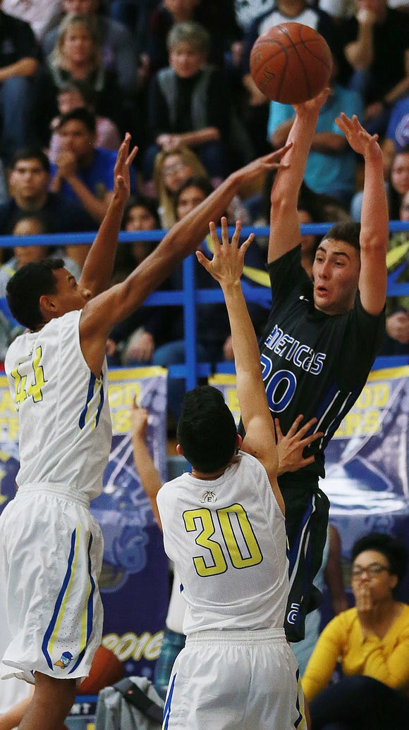 Americas' Sebastian Andrade, right, passes over Eastwood's
