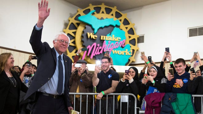 Democratic presidential candidate Sen. Bernie Sanders, I-Vt., waves as he arrives to speak during a United Auto Workers rally on Monday in Dearborn.